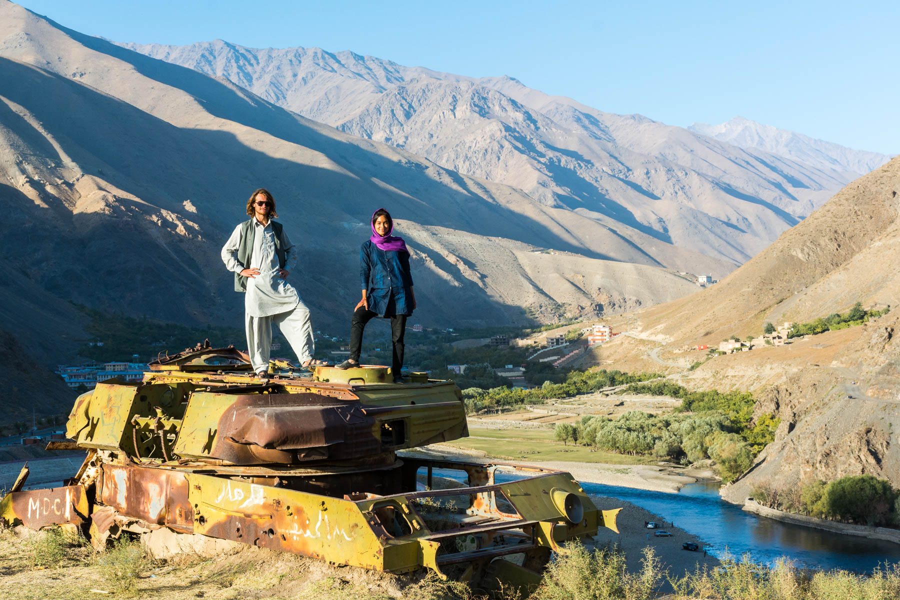 Standing on a tank in the Panjshir Valley outside of Kabul - Lost With Purpose