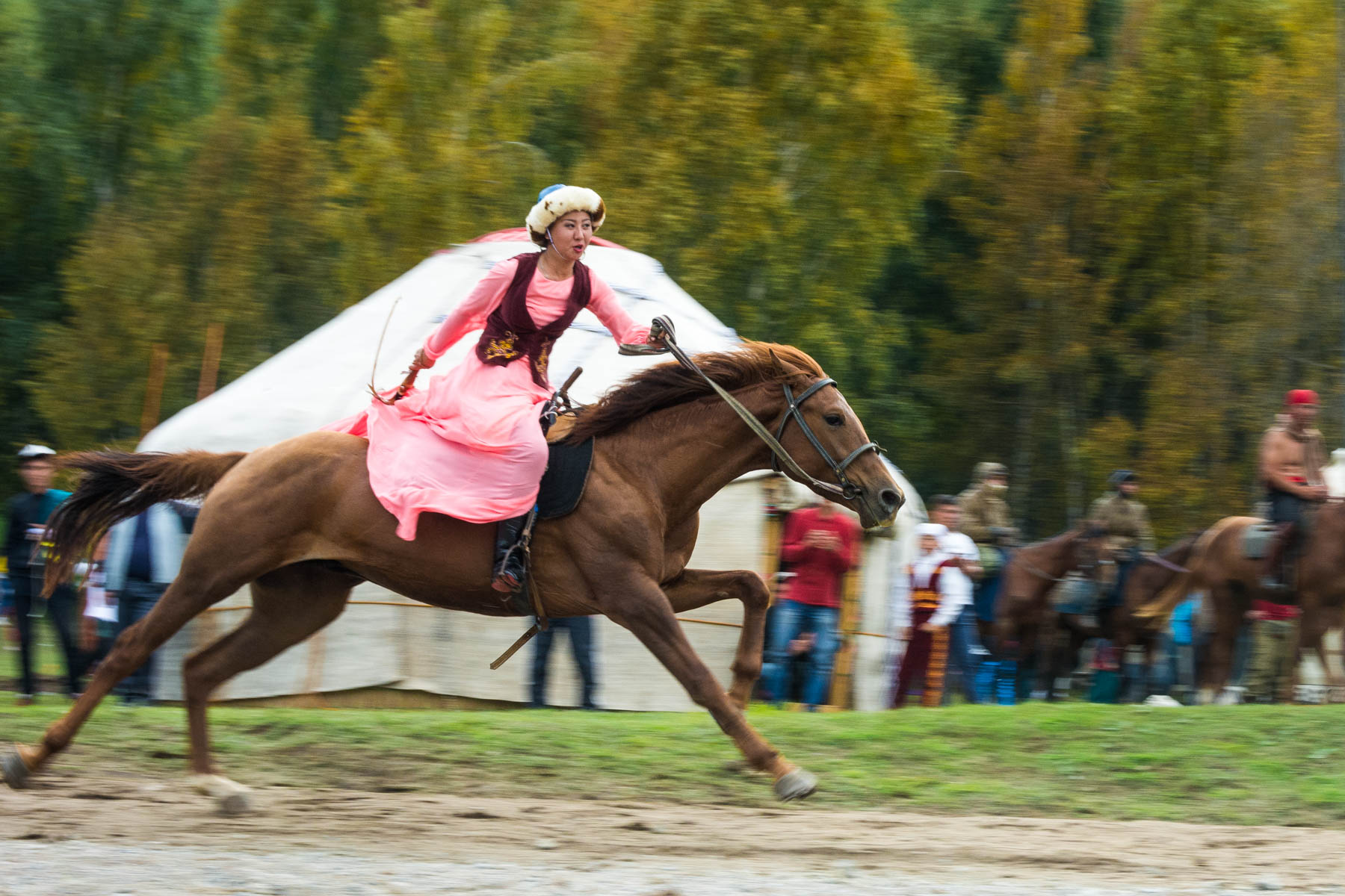 A performing woman riding a horse in Kyrgyzstan - Are the 2018 World Nomad Games worth the trip? - Lost With Purpose