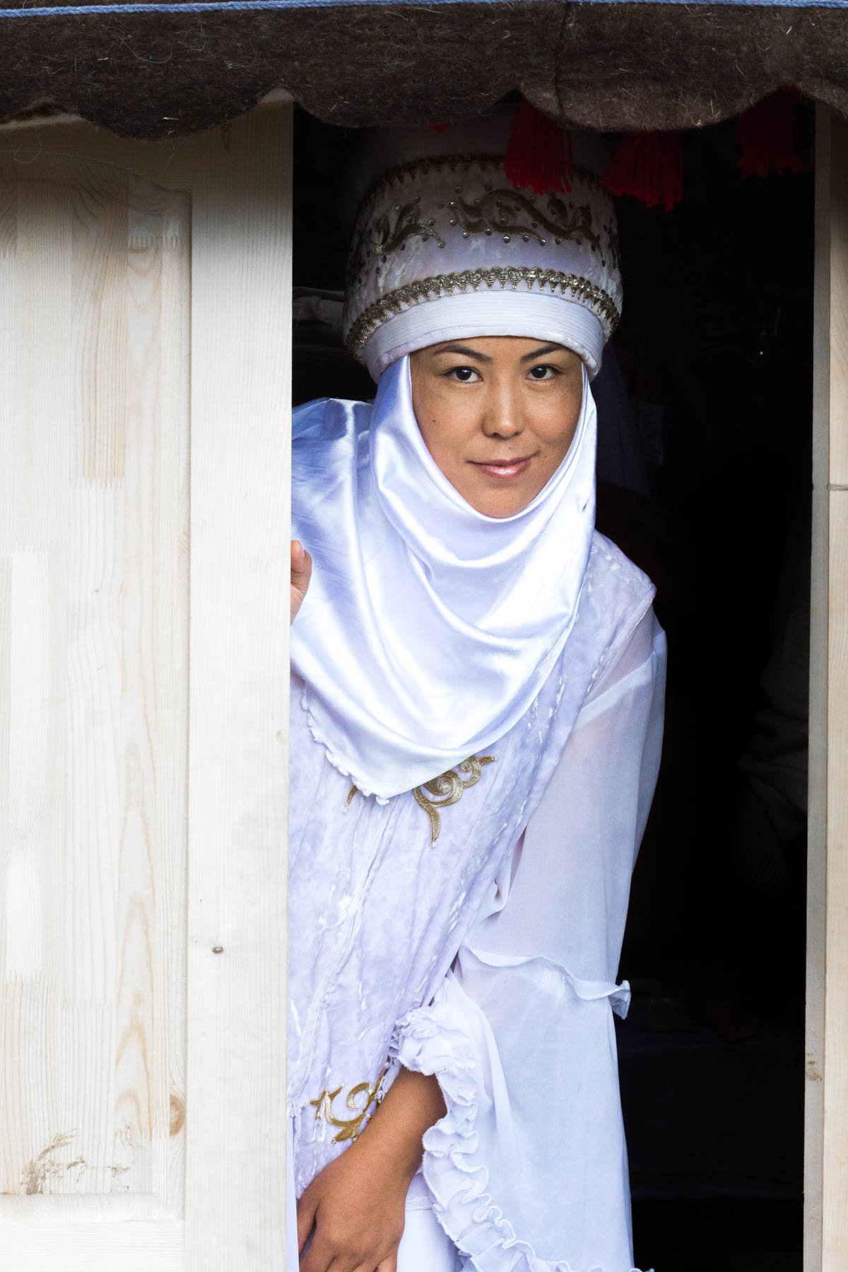 A Kyrgyz nomad girl in traditional clothes at the World Nomad Games in 2016 - Lost With Purpose