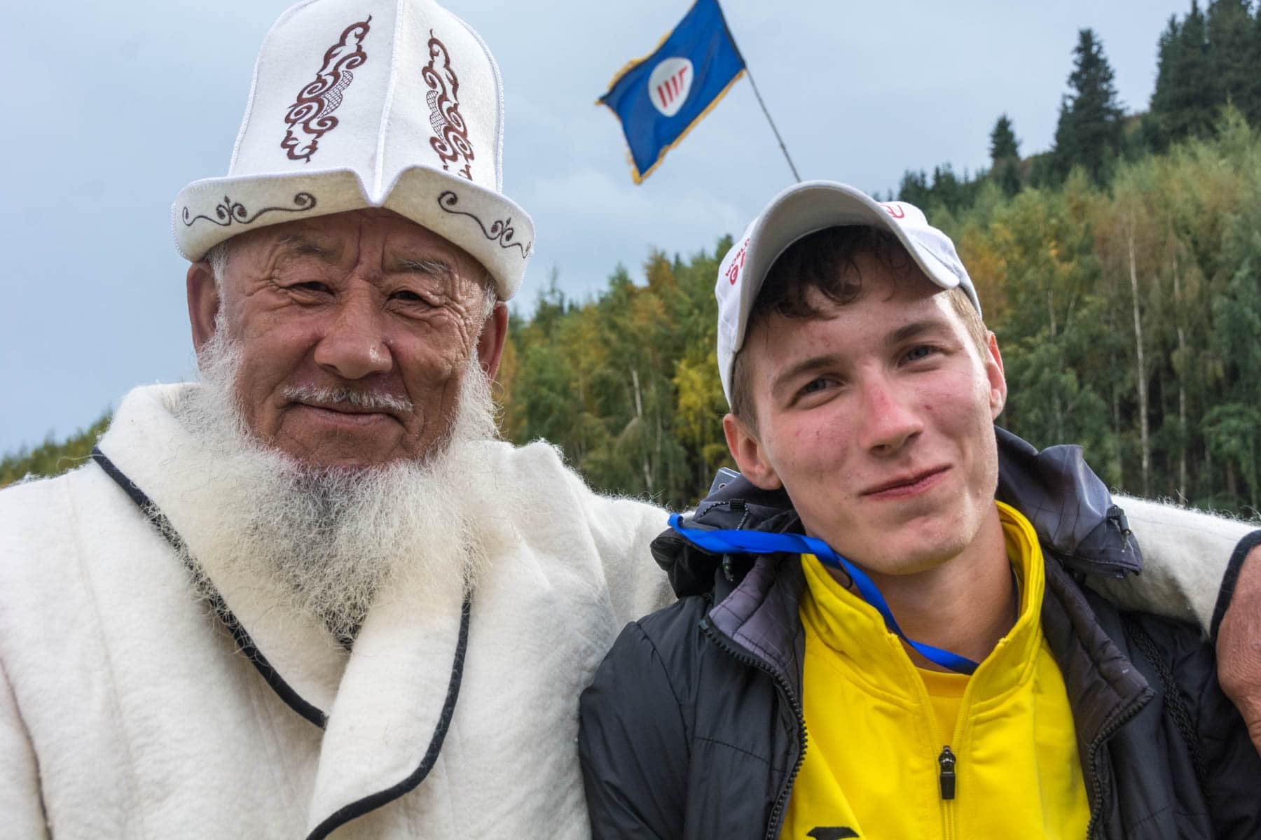 A volunteerand a Kyrgyz spectator at the 2016 World Nomad Games