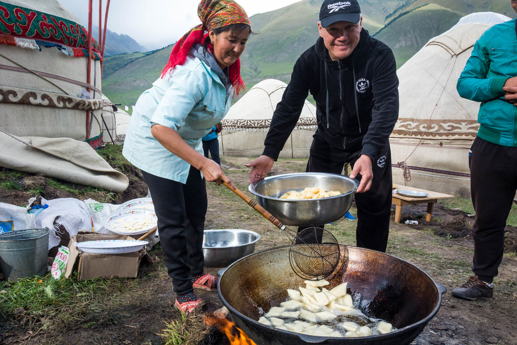 Nomads cooking borsok, a Kyrgyz fried dough snack -