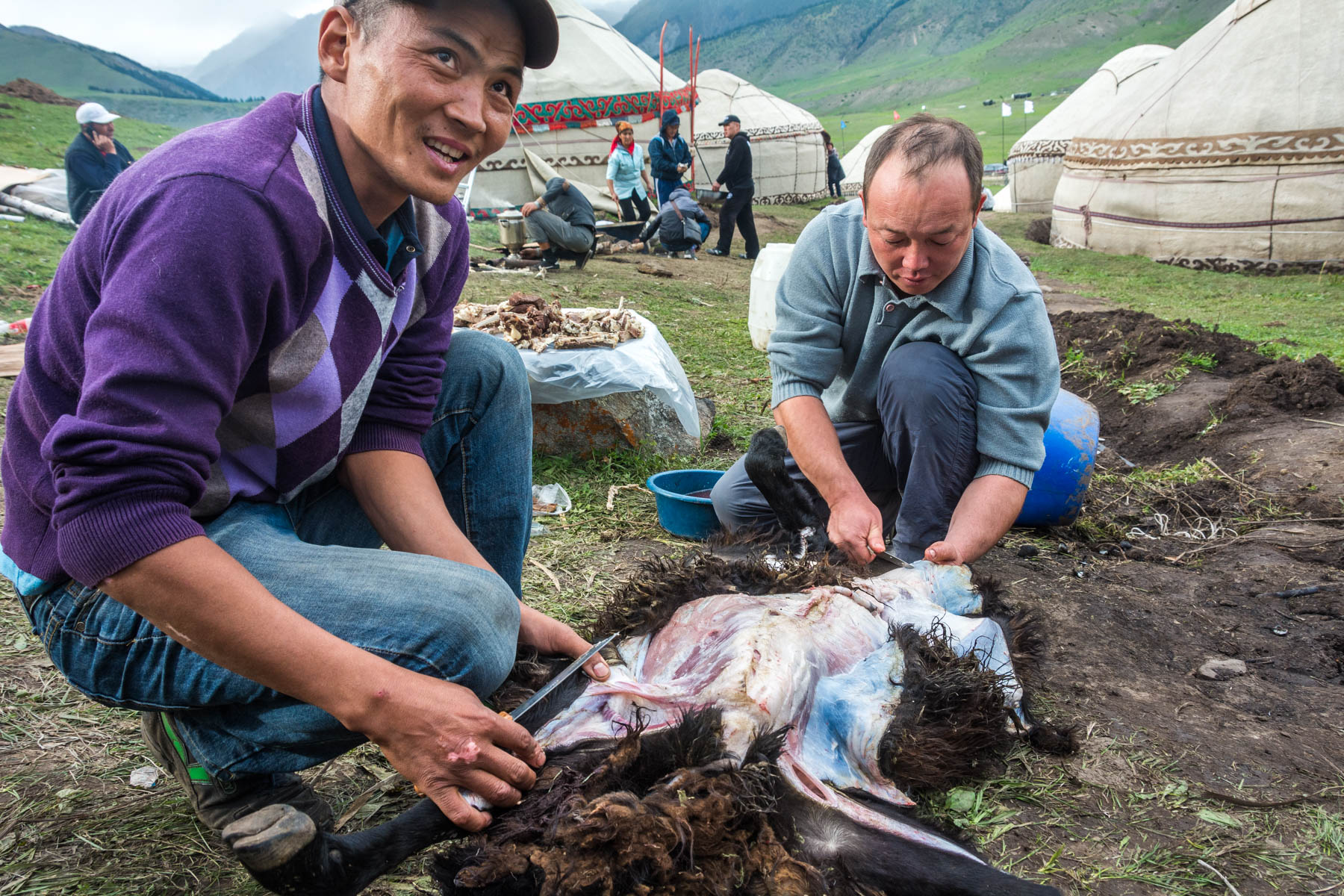 Two men preparing a sheep carcass at the 2016 World Nomad Games - Lost With Purpose